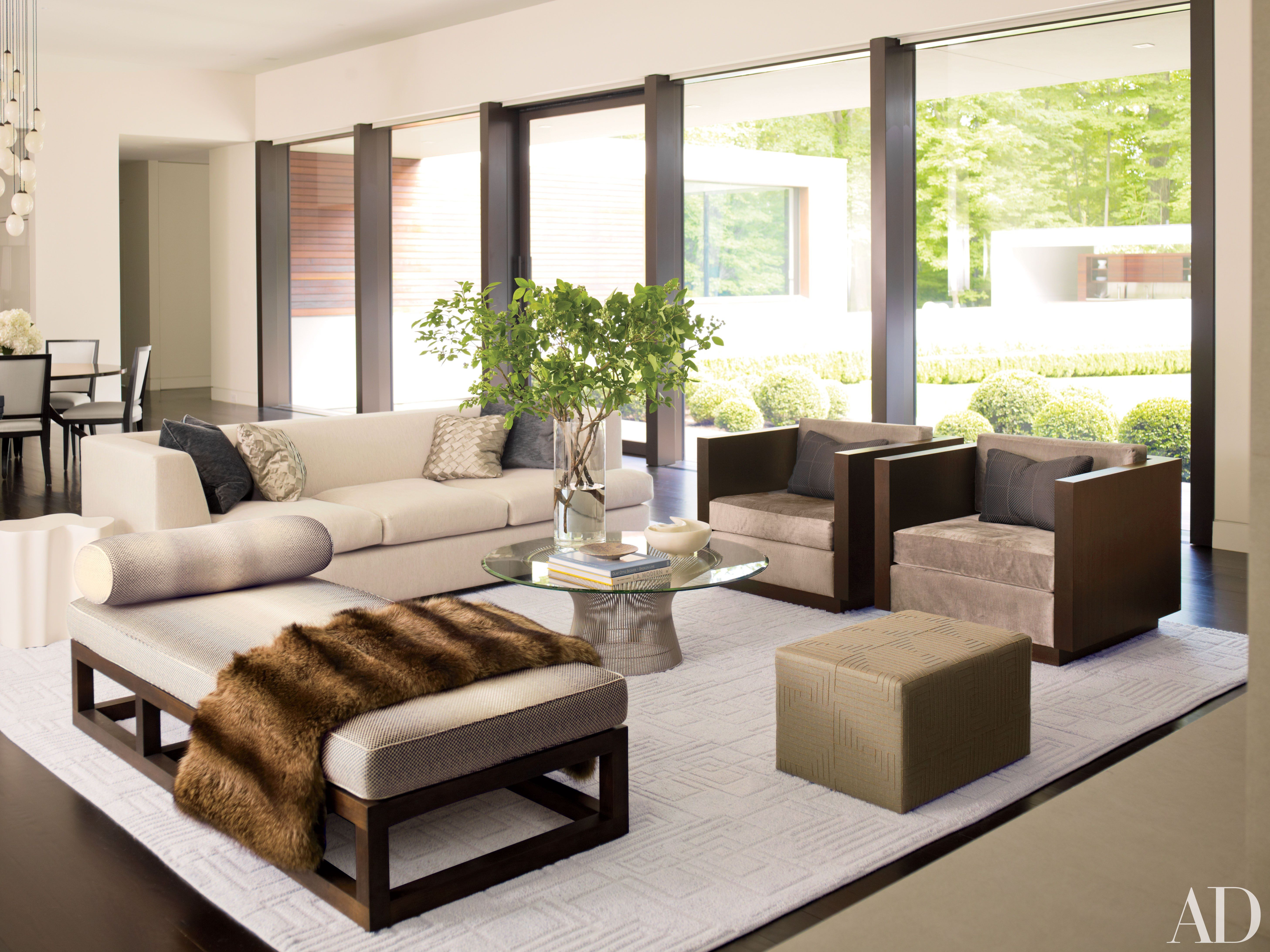 How To Incorporate Ottomans Into Your Living Room Decor Living