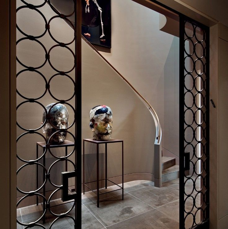 Typically Art Deco interior iron grid, with a sliding contemporary touch: