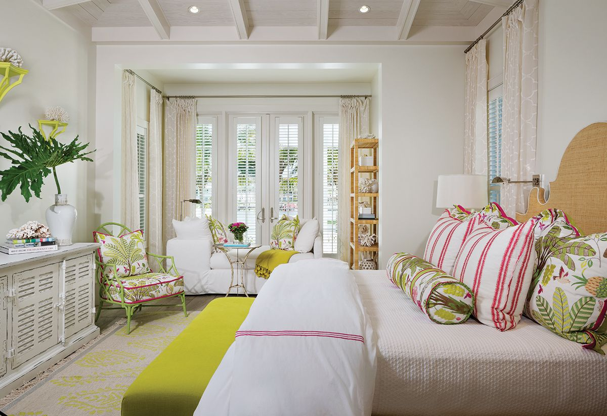 The Palm Beach Inspired Master Bedroom Has A Tropical Feel Created With Floral Accent Pillows An European White Oak Floors Florida Design Beach House Furniture Best tropical master bedroom