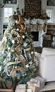 """minus the """"happy holidays"""" on the ribbon, this is an awesome living room décor set up! should say merry Christmas!"""