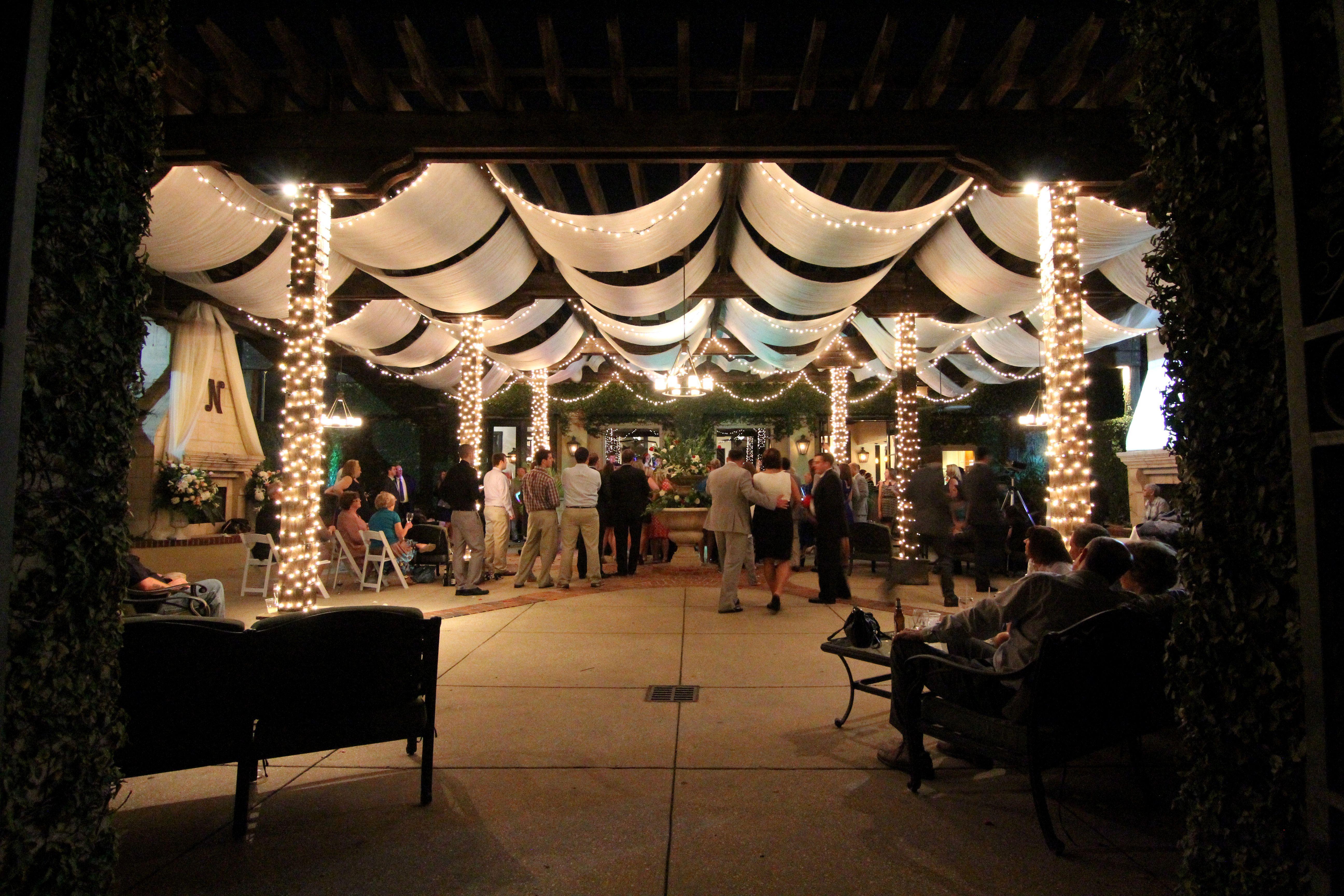 Mini Lights And Overhead Drapery Soften The Patio Of Azalea Manor In Mobile Al Wedding Reception Venues Pergola Lighting Pergola