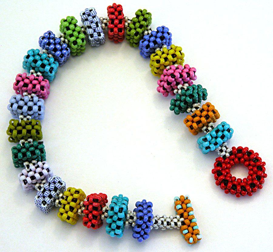 Nita E Kaufman: Right-angle weave cubes.