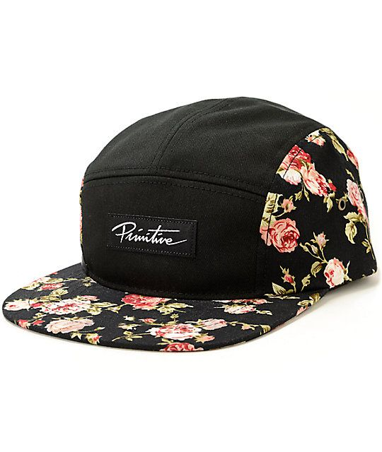 cf732799768 A rose floral print bill and side panels on a black low-profile 5 panel  design with a Primitive script logo at the front.