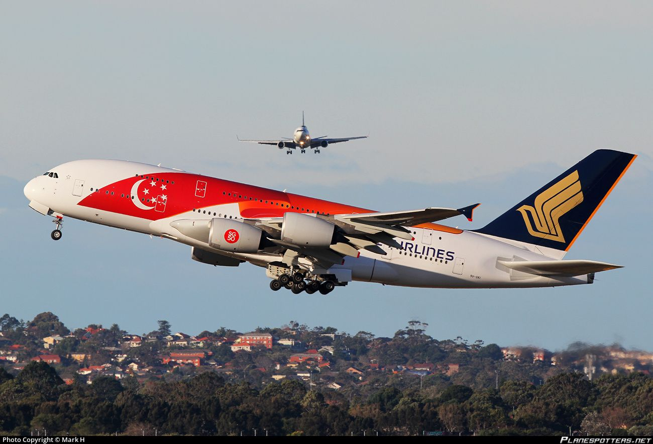 """Singapore Airlines Airbus A380-841 9V-SKI departing Sydney-Kingsford Smith International while a McDonnell Douglas MD-11 cargo jet approaches the cross runway, July 2015. Special """"Singapore's 50th Birthday"""" livery. (Photo: Mark H)"""