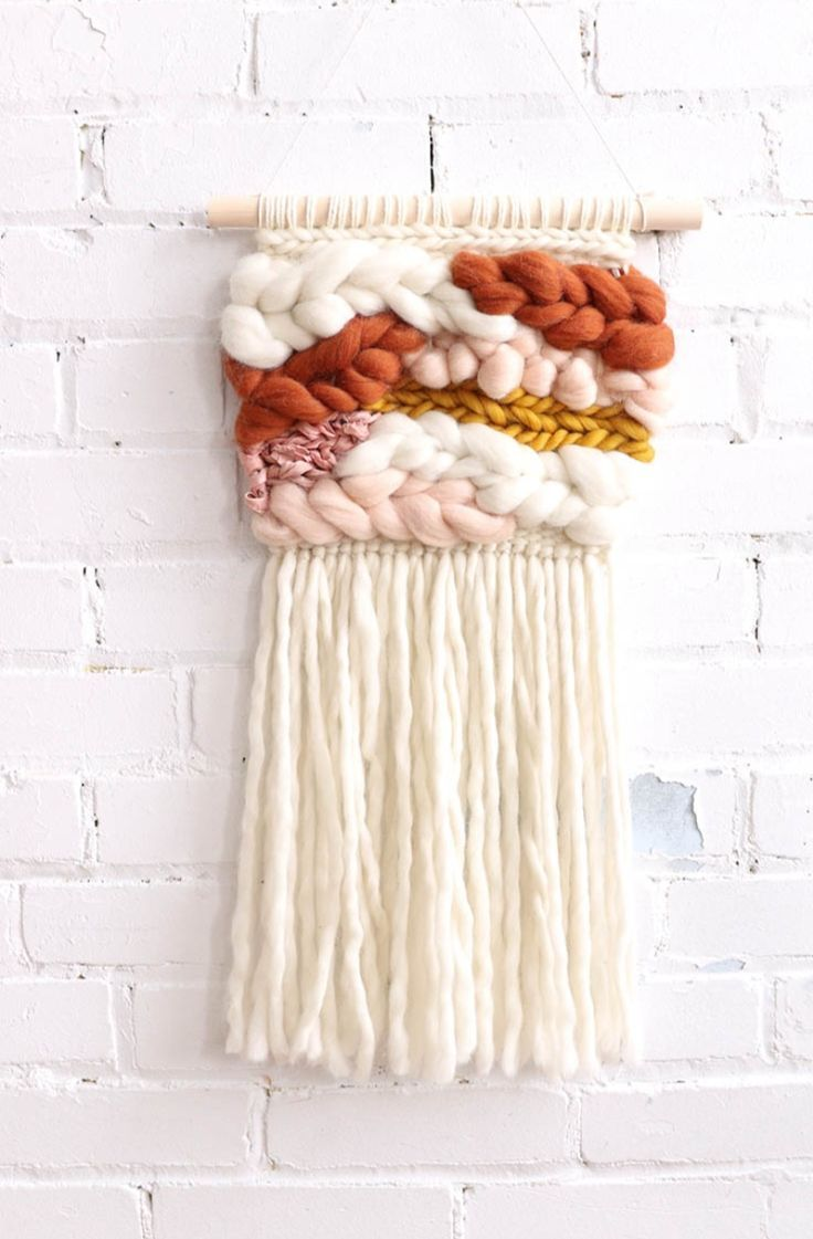 Handmade with the most gorgeous, fluffy materials, this exclusive handmade wall hanging is lovely for a nursery, a surf lodge decor or a boho bedroom. It will add so much texture and interest to a wall! An easy fix for any blah wall. Handwoven Wall Hanging | Baba Souk #handmadehome #fibreart #textilelovers #ad