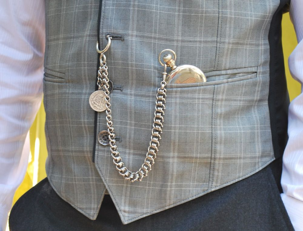 7869515f7 pocket watch & Albert chain (with spring ring), worn from vest buttonhole  to vest pocket, featuring a coin fob on the drop