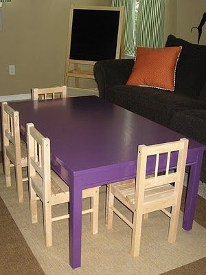 Large kids art table made from an Ikea dining room table. Cut the legs down