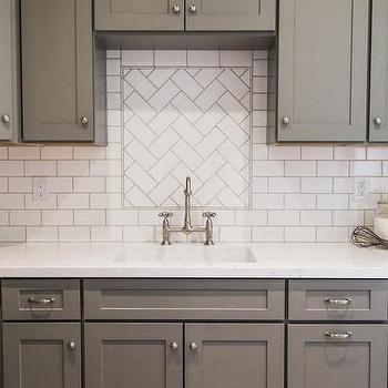 Gray shaker kitchen cabinets with white subway tile for Subway tile backsplash herringbone pattern