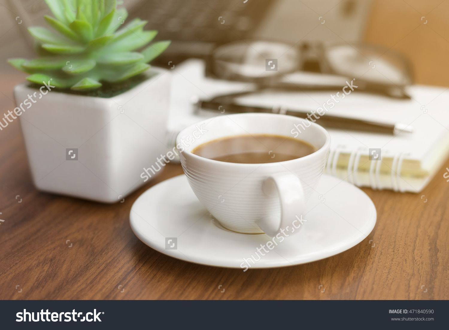 A coffee cup on the office desk in sunrise is a happy time. #coffee #cup #notebook #office #business