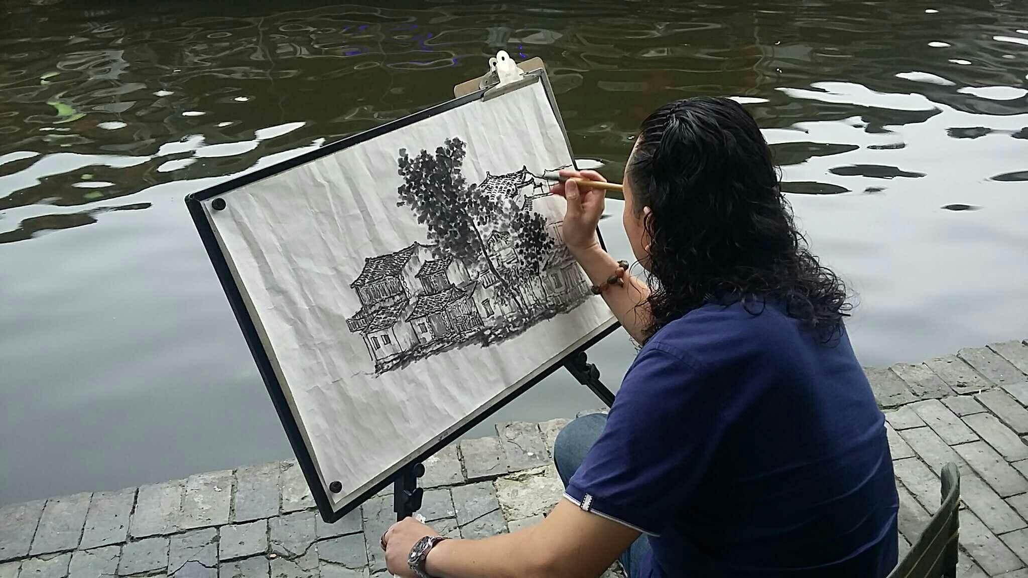 偶遇西塘不知名的画家