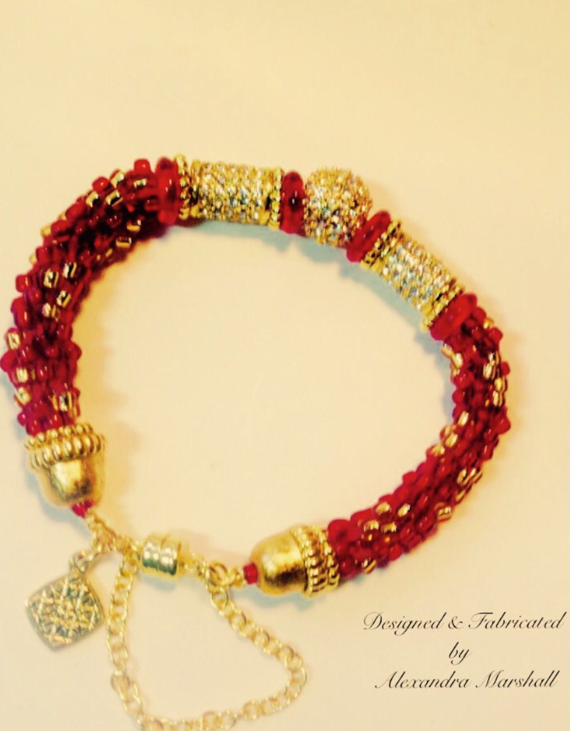 Love this elegant ruby red and gold beaded bracelet by alexandra