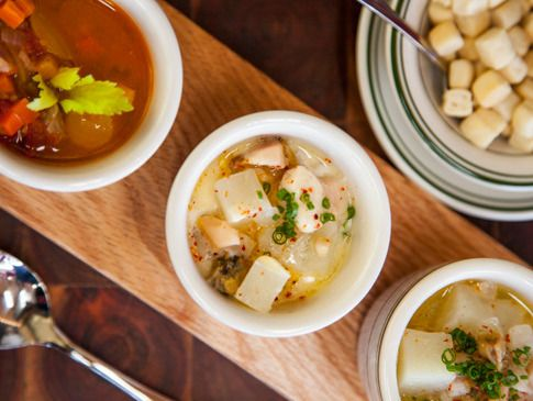 A trio of New England, Manhattan, and Rhode Island clear chowder at Connie and Ted's.