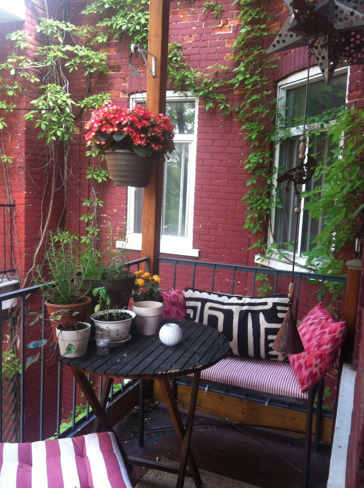 Apartment balcony ideas pictures to pin on pinterest - Bright And Inviting Small Balcony With Hanging Plants For Added Colour For Similar Pins Please