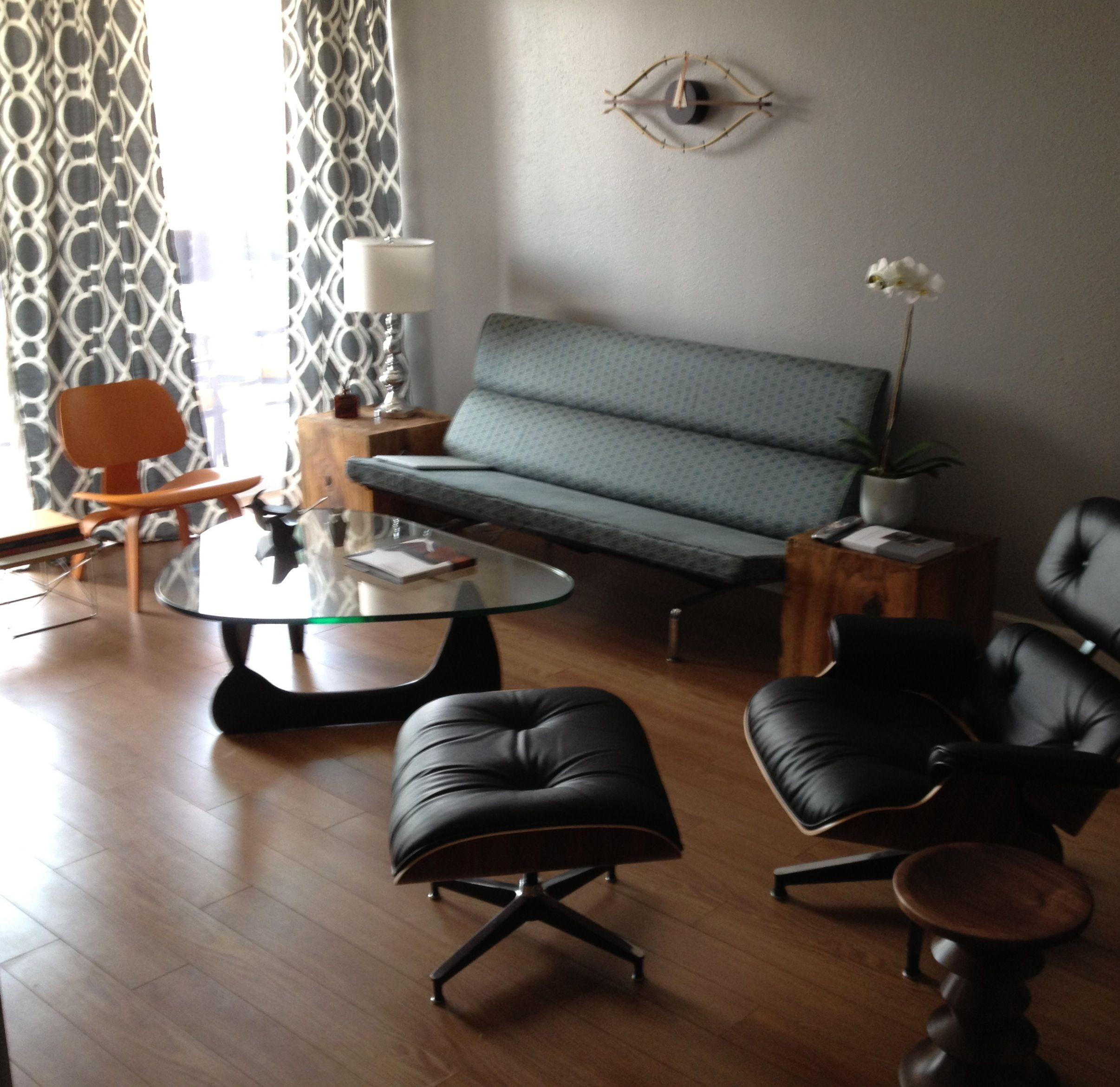 Eames Sofa Compact, Orange LCW, Eames Lounge Chair, Noguchi Table.