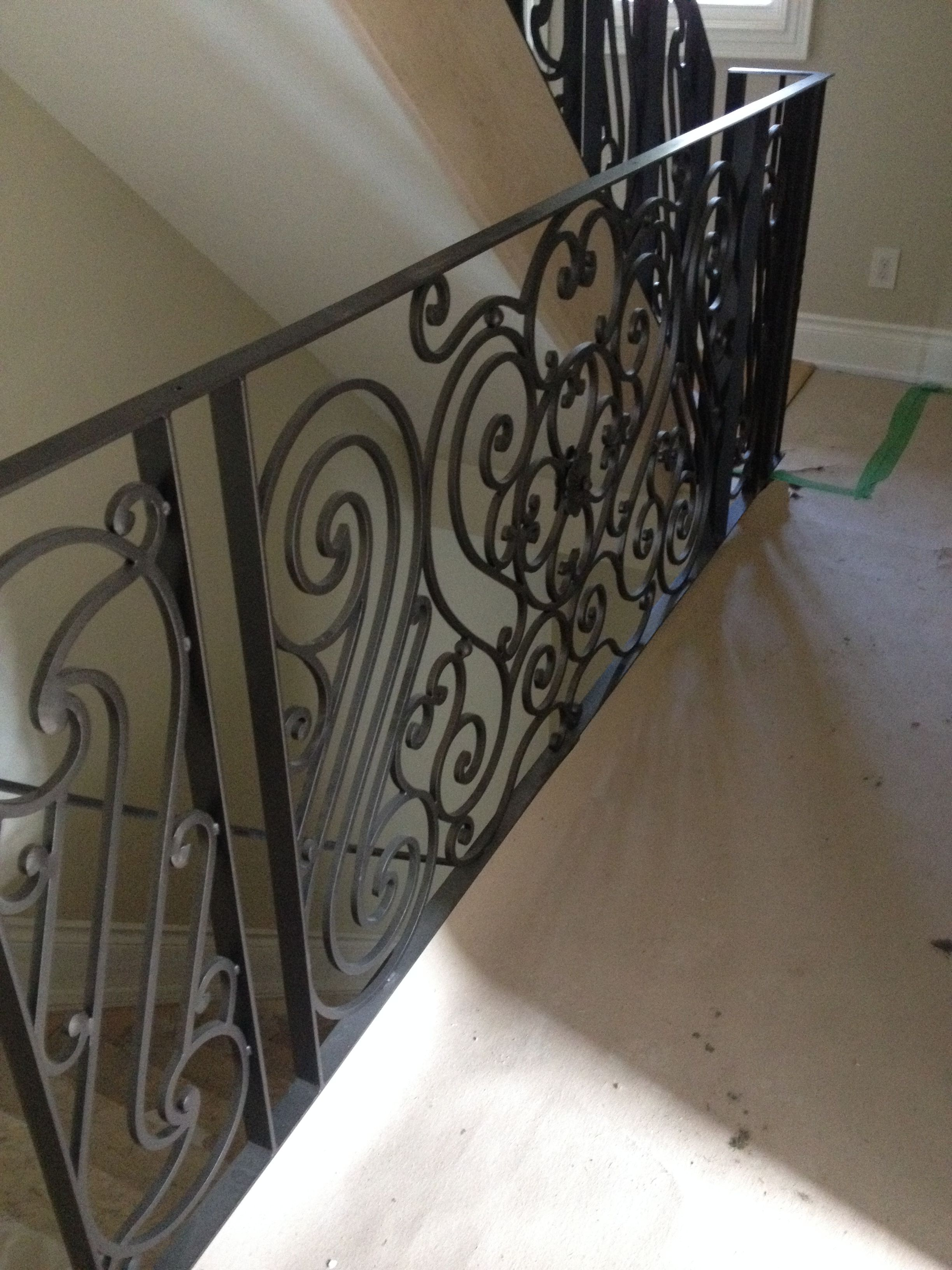 Wrought Iron Railing Capped With Wood Hand Rail