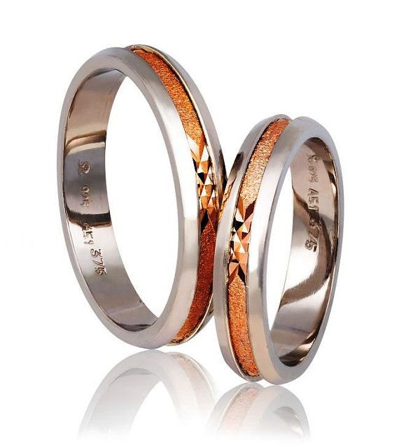 Check out this item in my Etsy shop https://www.etsy.com/listing/483644325/silver-and-gold-wedding-band-rings