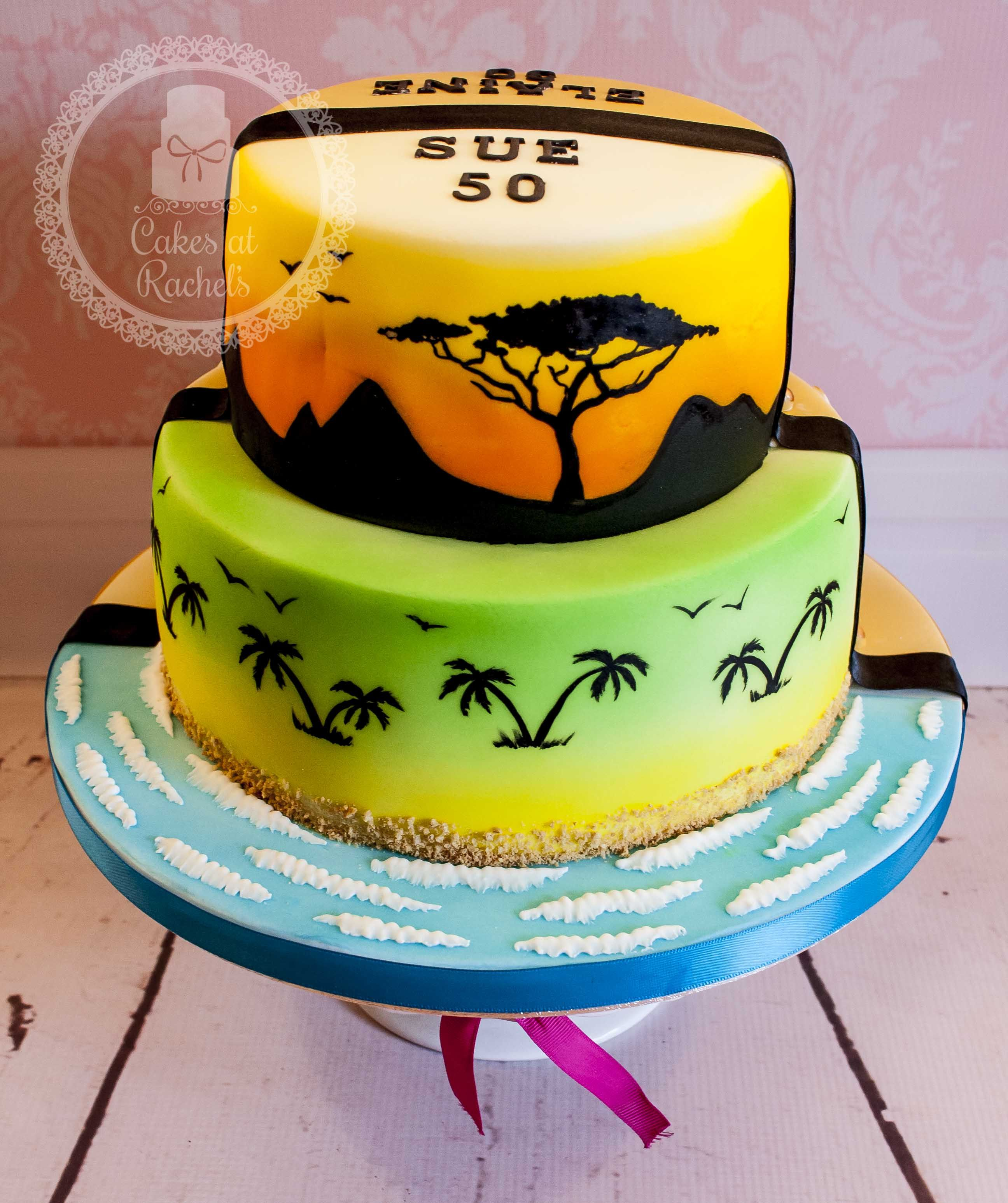 Double sided two tier cake decorated with travelmusic