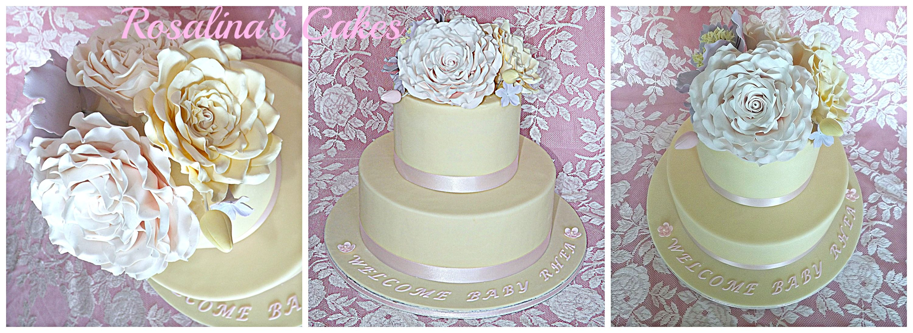 Gorgeous baby shower cake in cream color with pastel colored flowers.This could also be a simple wedding cake.