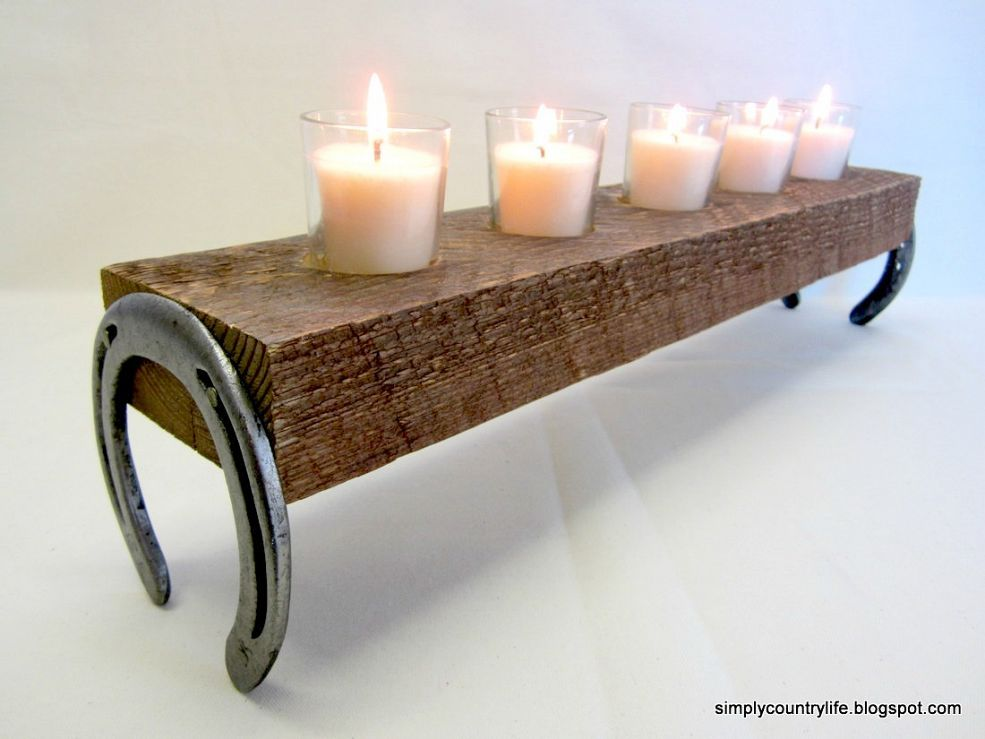 Put together a rustic candle holder from old horseshoes & reclaimed wood. - Repurpose Horseshoes And Wood Into A Rustic, Country Candle Holder
