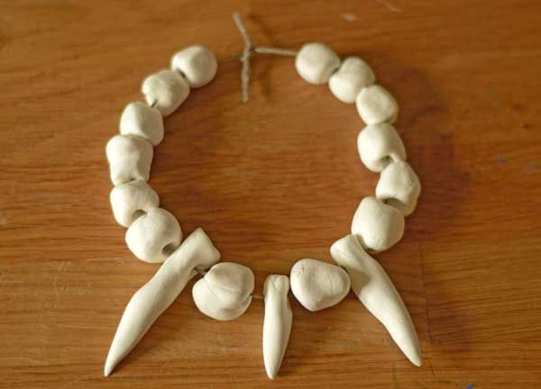 Make your own Stone Age necklace with this easy tutorial for kids.