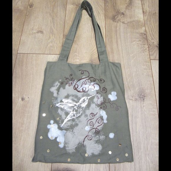 Small Tote Bag Small army green tote bag with 2 handles. Has print on front with humming bird & a few sequences. Inside has light pink liner. There is a small pocket located in the interior of the bag. Bags Totes