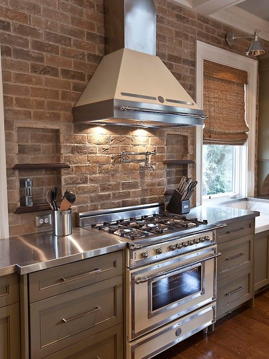 Elegant Stainless Counter, Modern Stove And Range Hood That Doesnu0027t Look Cold,  Exposed Brick Wall, Ceiling With Architectural Detail,    And Grey Painted  Cabinets!