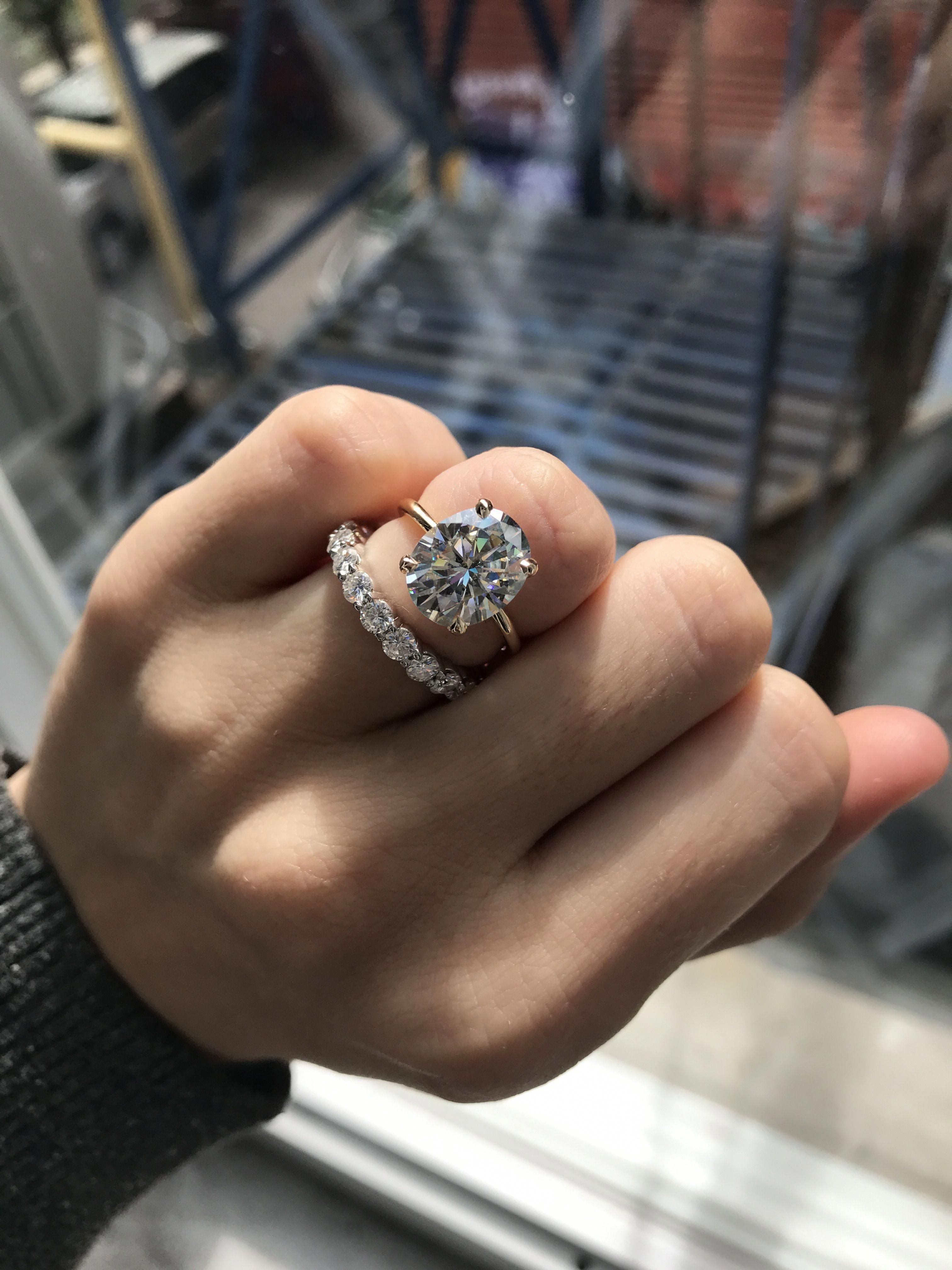Four 4 carat Juno solitaire moissanite in yellow gold