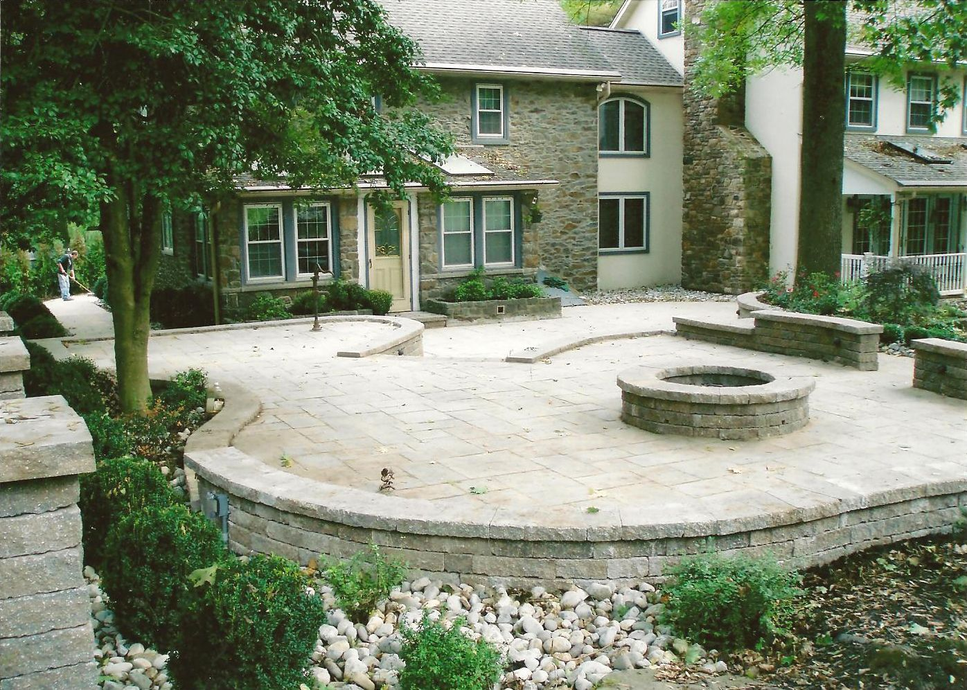 Hardscaping Ideas For Backyards rustic backyard patio inspiration come with low stacked stone firepit and rattan chairs with Hardscaping Ideas For Backyards Backyard Design