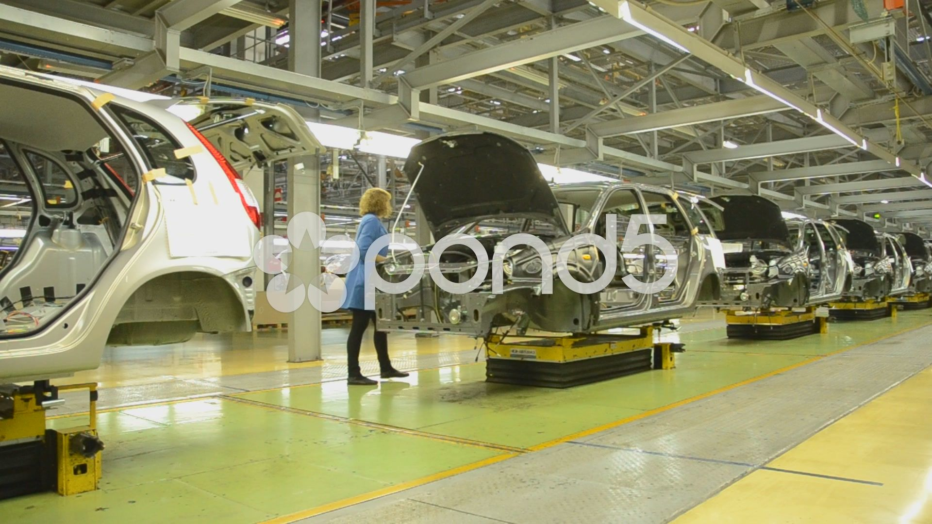 People Work At Assembly Of Cars Lada Kalina On Conveyor Of Factory