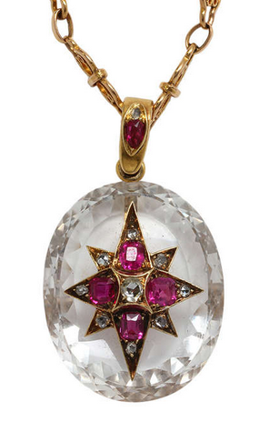d01f0e97a0e255 Victorian large oval shaped faceted rock crystal pendant, measuring 44 x  25mm. Embellished with an 8 point elongated gold star set with 9 rose cut  diamonds ...
