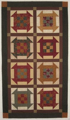 "This tablerunner is based on the ""All in a Row"" pattern from Kim Diehl's ""Simple Comforts"" book."