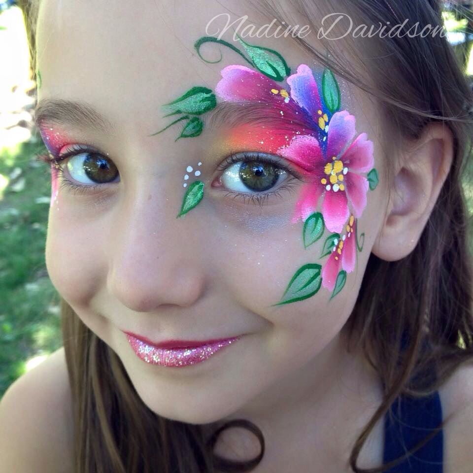 Bright flower eye design face painting flower face for Floral painting ideas