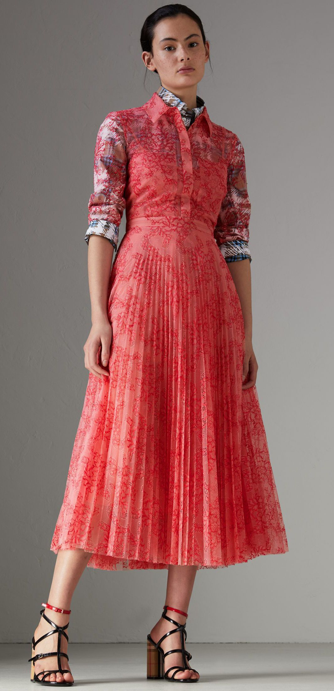 An Italian lace dress by  Burberry shaped with a nipped-in waist and sharp  knife pleats. A detachable silk slip lines the design a65ad5c14358