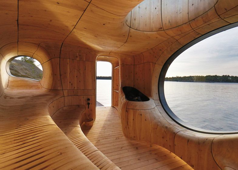 Partisansu0027 Lakeside Sauna Takes The Form Of A Cavernous Wooden Grotto