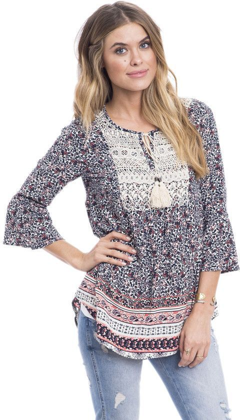 dfbd4305726 This floral boho blouse features an all over floral border print in billowy  peasant body