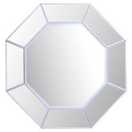 """Showcasing an octagonal metal frame and shimmering silver finish, this eye-catching wall mirror brings a pop of style to your living room or master suite.  Product: Wall mirrorConstruction Material: Mirrored glass and metalColor: Silver  Features: Beveled edgesDimensions: 23.5"""" H x 23.5"""" W"""