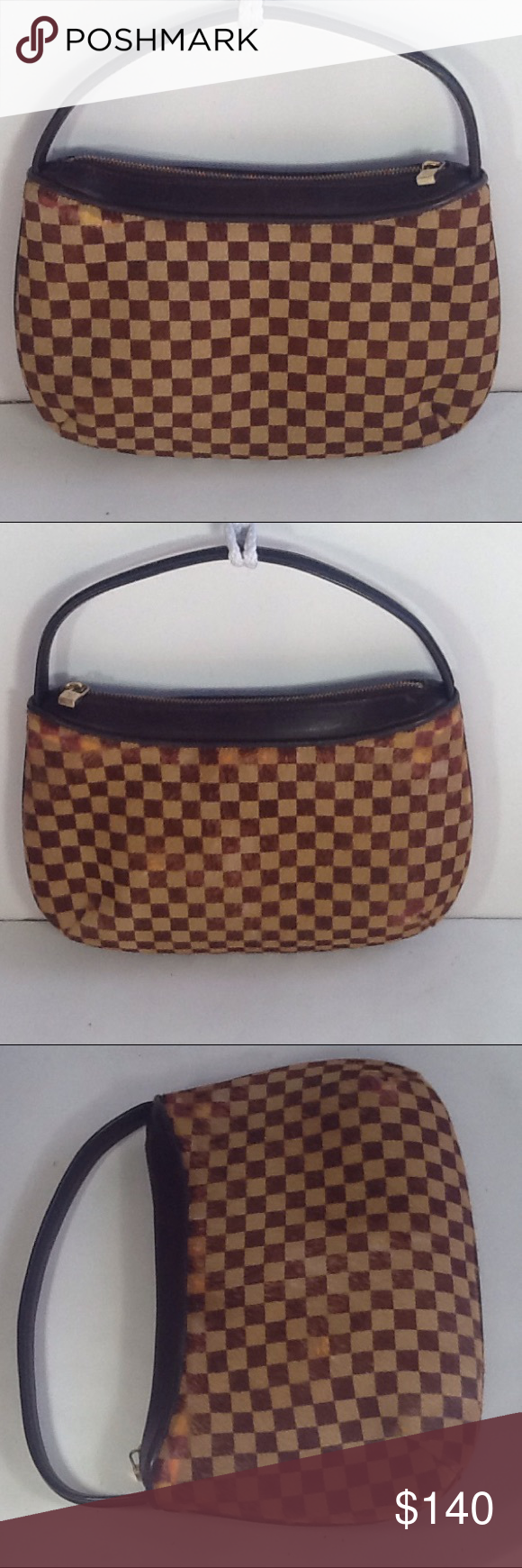 a001a19805dd Authentic Louis Vuitton Damier Sauvage Tigre Bag. Some discoloration are on  the suede. The