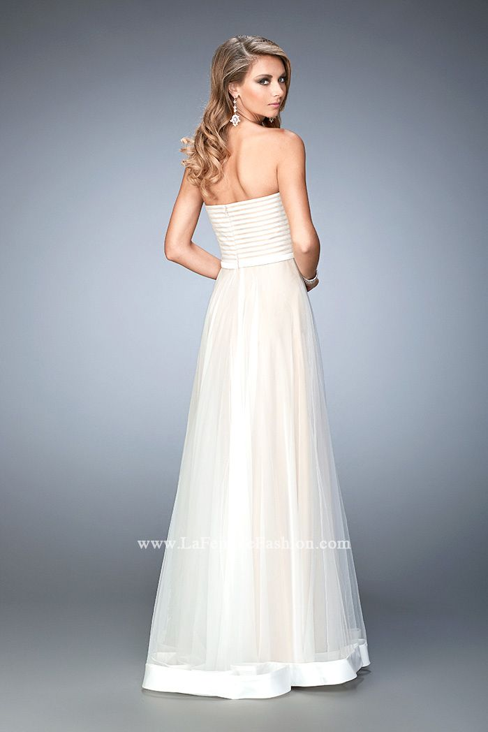 You are sure to feel glamorous and beautiful in La Femme Style #22536 available at Whatchamacallit Boutique