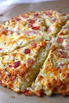Ham and Cheese Scones ~ Canadian ham, cheddar cheese and onions baked into a hearty scone. The perfect sidekick to your favorite salad or soup.