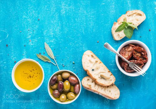Mediterranean snacks set. Olives oil sun-dried tomatoes herbs and sliced ciabatta bread on by 2enroute  IFTTT 500px