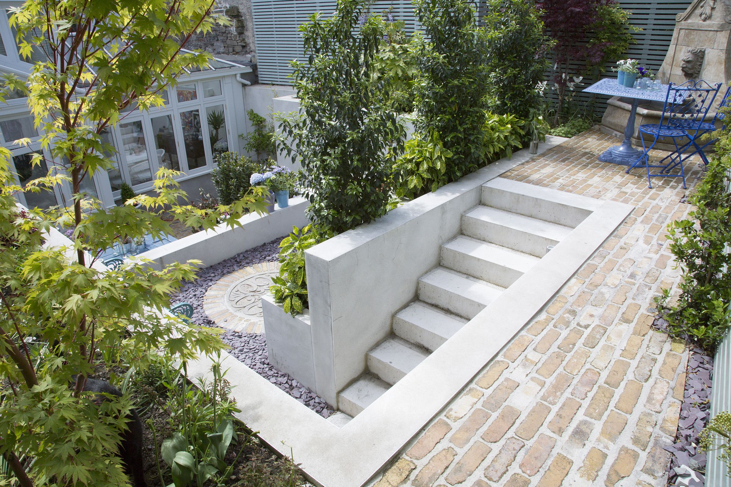 stepped three tiered garden design with salvaged bricks and poured