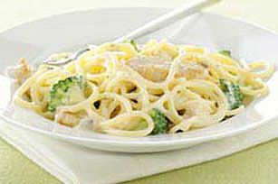 VELVEETA and condensed cream of mushroom soup make a delicious sauce for chicken and broccoli served with spaghetti.