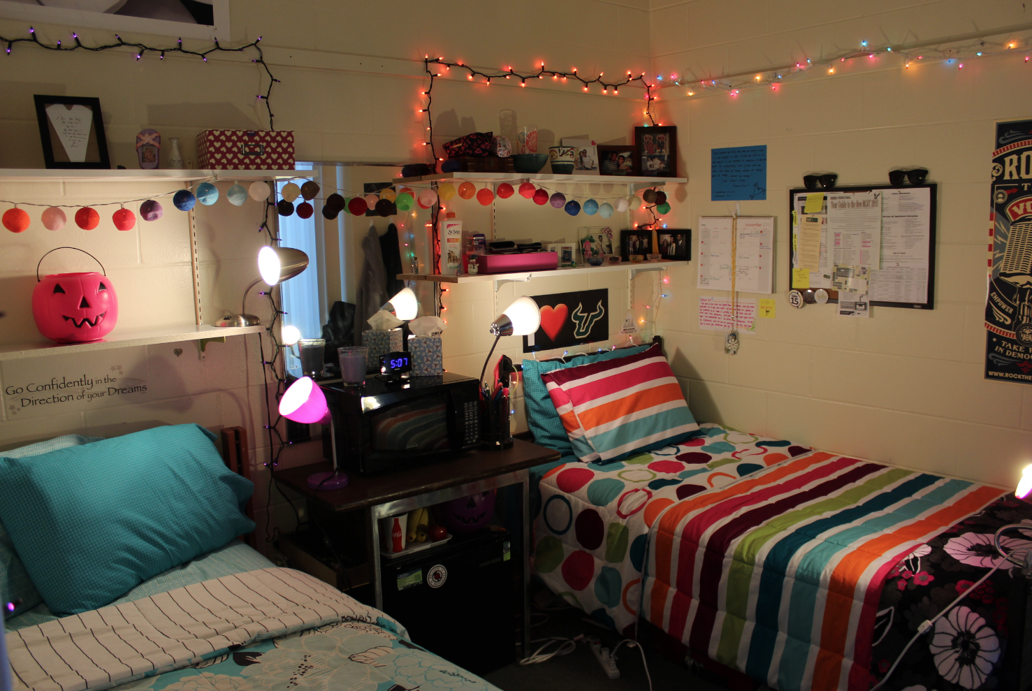 Colorful lights hang from the ceiling in this usf student - How to hang lights in room ...