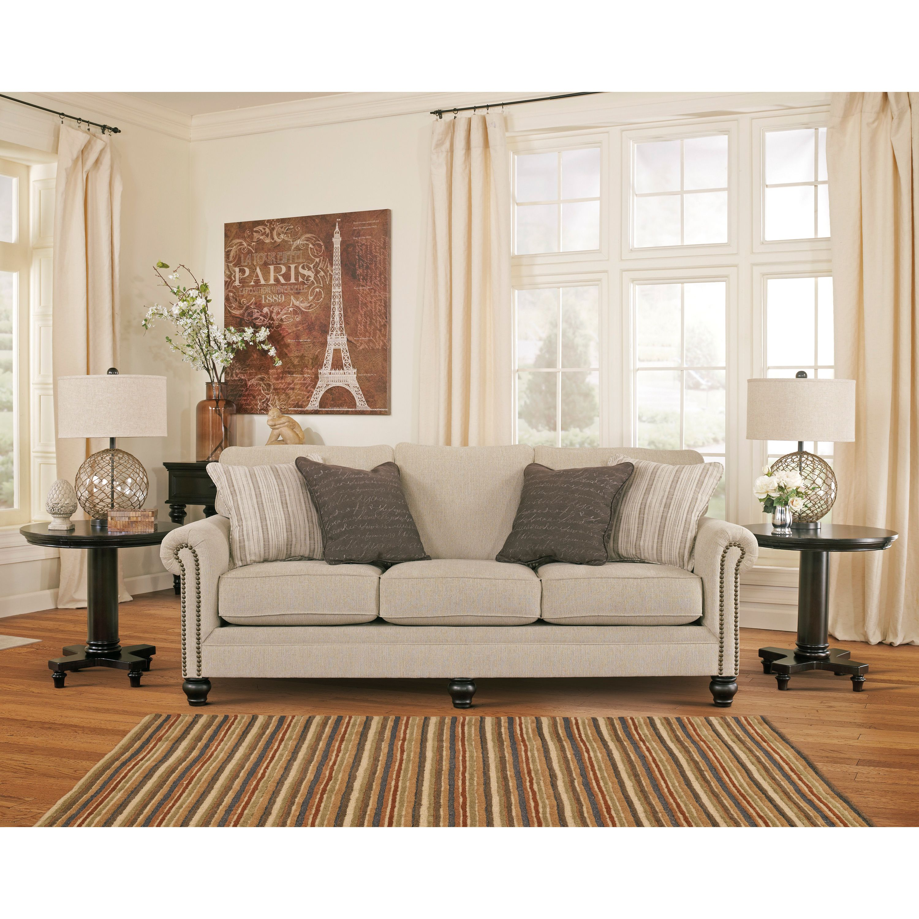 Upholstered In Neutral Linen Tones This Elegant Milari Sofa Features Clic Rolled Arms Studded