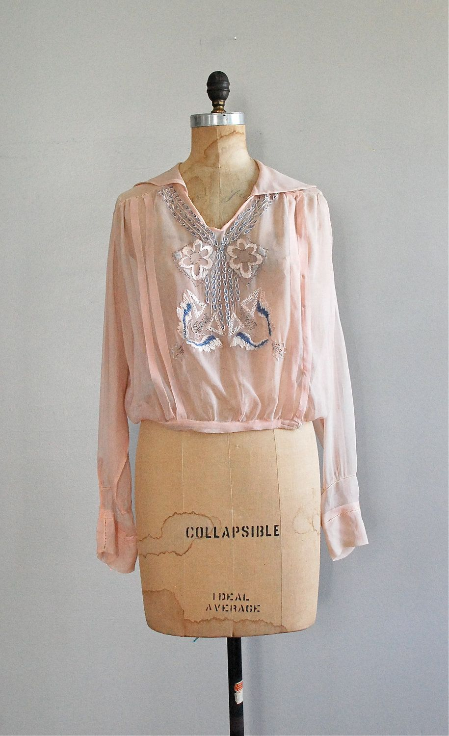 734664807775f early 1920s very pale pink sheer silk tunic style blouse with intricate blue  floral embroidery   tiny metal beads