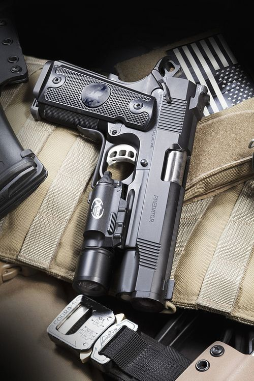 Nighthawk Custom M1911A1 Semi-Auto Handgun Cal .45ACP With a Surefire X300 Tactical Light