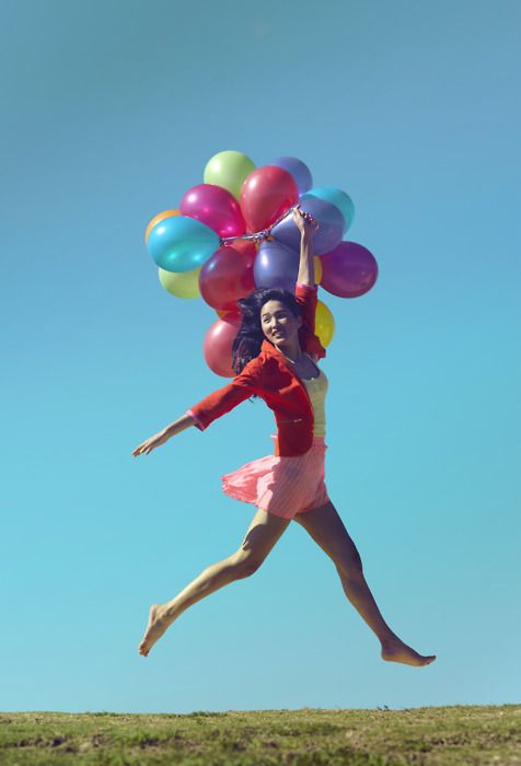 Jump with balloons. Seems to be the thing to do.