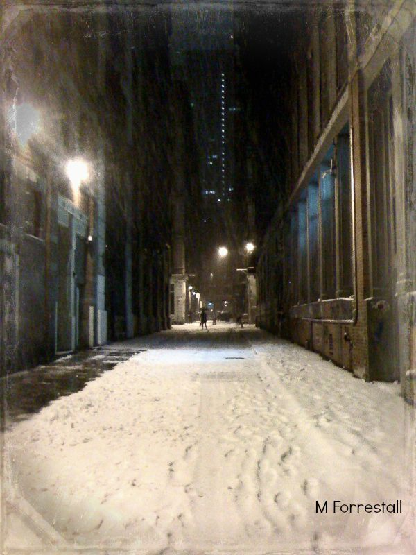 Alleyway off Canal Street in Chinatown, NYC during snowstorm in December 2013.