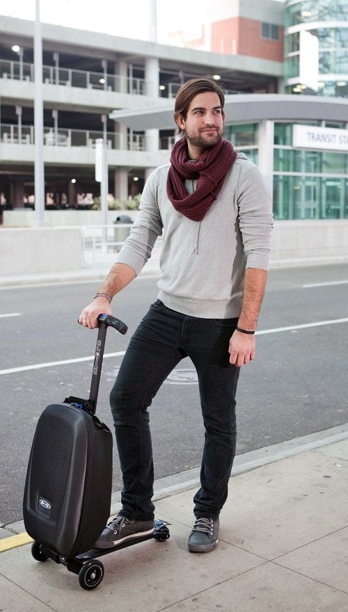 Versatile micro luggage scooter goes from a carry on to for Motorized ride on suitcase