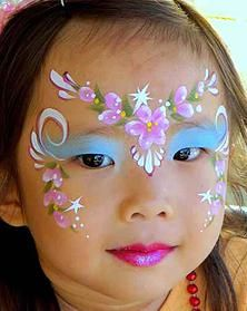 flower fairy face painting; I like how floral buds were carried down to the cheek. Cute!